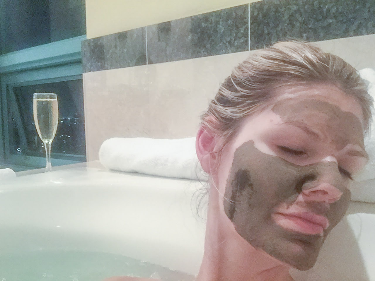 Relaxing with a May Lindstrom Problem Solver Face Mask to brighten skin
